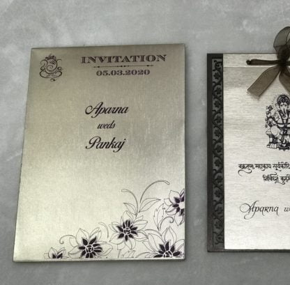 lasercut card made in mdf (wooden material) with inserts and box envelope made of shimmering mettalic finished paper.