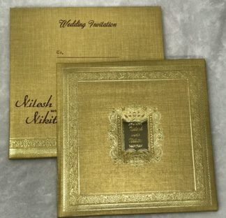 hardbound wedding card made of premium golden texture mettalic paper and golden acrylic mirror on main card