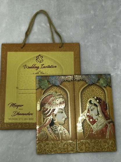 Traditional wedding cards with dulha and dulhan (groom and bride)