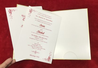 White embossed card with gold base