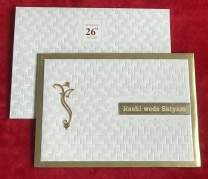 A simple white embossed elegant card sticked on  golden padding  with golden acrylic name plate.