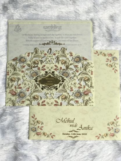 Laser cut wedding card with floral design and acrylic name plate