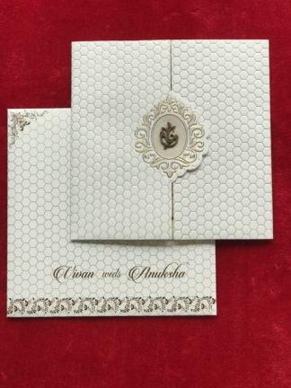 White laser cut wedding card in 3 fold pattern